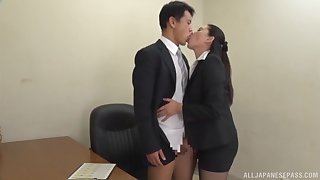 Deep sex after the clothed Japanese office MILF gives head