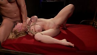 Busty womanlike endures sex during bondage with horny master